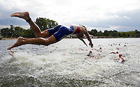 25 JUL 2010 - LONDON, GBR - Ivan Tutukin dives into the water at the start of the second lap of the mens race of the London round of the ITU World Championship Series triathlon (PHOTO (C) NIGEL FARROW)