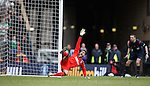 Wes Foderingham celebrates as Tom Rogic baloons the ball over the bar to seal victory for Rangers