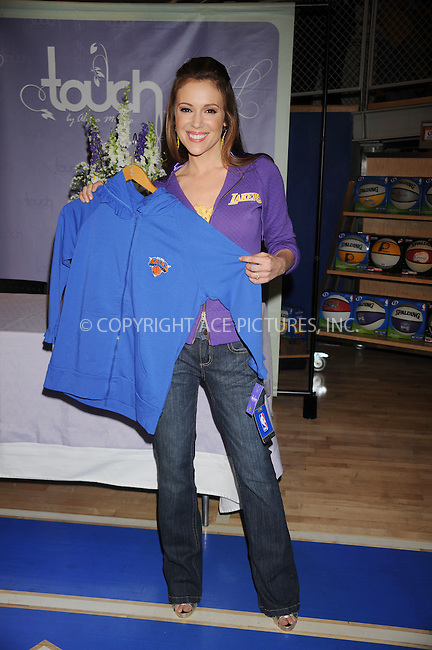 WWW.ACEPIXS.COM . . . . .  ....April 15 2009, New York City....Actress Alyssa Milano signed pictures for fans to promote the 'Touch' Collection at the NBA Store on April 15, 2009 in New York City.....Please byline: KRISTIN CALLAHAN - ACEPIXS.COM..... *** ***..Ace Pictures, Inc:  ..tel: (212) 243 8787..e-mail: info@acepixs.com..web: http://www.acepixs.com
