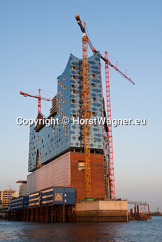 Hamburg-Germany - May 04, 2013 -- HafenCity: construction site of the complex Elbphilharmonie Concert Hall (Elbe Philharmonic Hall), hotel and apartments on top of an old warehouse (Kaispeicher), port / harbour -- Photo: © HorstWagner.eu