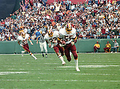 Washington Redskins linebacker Mel Kaufman (55) returns an interception against the Los Angeles Raiders at RFK Stadium in Washington, D.C. on October 2, 1983.  Trailing Kaufman on the play are strong safety Curtis Jordan (22) and free safety Mark Murphy (29).<br /> Credit: Howard L. Sachs / CNP
