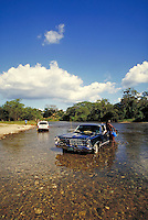 Man washing car in Macal River San Ignacio, Cayo District, Belize. San Ignacio Cayo District Belize Central America.