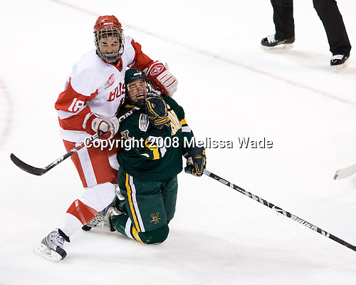 Brandon Yip (BU - 18) and Dean Strong (Vermont - 8) battle. The University of Vermont Catamounts defeated the Boston University Terriers 4-3 on Saturday, November 22, 2008, at Agganis Arena in Boston, Massachusetts.