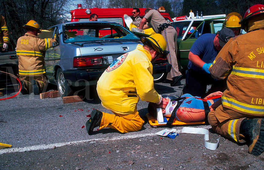 Rescue workers practice at a simulated drunk driving accident.