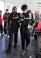 Wednesday 07 August 2013<br /> Pictured L-R: Roland Lamah and Ki Sung Yueng about to board their aeroplane at Cardiff Airport.<br /> Re: Swansea City FC travelling to Sweden for their Europa League 3rd Qualifying Round, Second Leg game against Malmo.