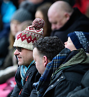 Lincoln City fans watch their team in action<br /> <br /> Photographer Chris Vaughan/CameraSport<br /> <br /> The EFL Sky Bet League Two - Lincoln City v Grimsby Town - Saturday 19 January 2019 - Sincil Bank - Lincoln<br /> <br /> World Copyright &copy; 2019 CameraSport. All rights reserved. 43 Linden Ave. Countesthorpe. Leicester. England. LE8 5PG - Tel: +44 (0) 116 277 4147 - admin@camerasport.com - www.camerasport.com