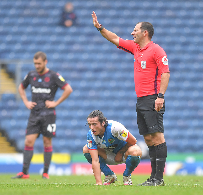 Blackburn Rovers' Lewis Travis feels the pain of being caught by the ball in a painful area<br /> <br /> Photographer Dave Howarth/CameraSport<br /> <br /> The EFL Sky Bet Championship - Blackburn Rovers v Reading - Saturday 18th July 2020 - Ewood Park - Blackburn<br /> <br /> World Copyright © 2020 CameraSport. All rights reserved. 43 Linden Ave. Countesthorpe. Leicester. England. LE8 5PG - Tel: +44 (0) 116 277 4147 - admin@camerasport.com - www.camerasport.com