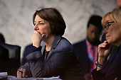 United States Senator Amy Klobuchar (Democrat of Minnesota) listens to the testimony of ChairBoard of Governors of the Federal Reserve System Jerome Powell during the U.S. Congress Joint Economic Committee hearing on Capitol Hill in Washington D.C., U.S., on Wednesday, November 13, 2019.<br /> <br /> Credit: Stefani Reynolds / CNP