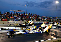 Jul. 19, 2013; Morrison, CO, USA: NHRA top fuel dragster driver Antron Brown (near lane) races alongside Tony Schumacher during qualifying for the Mile High Nationals at Bandimere Speedway. Mandatory Credit: Mark J. Rebilas-
