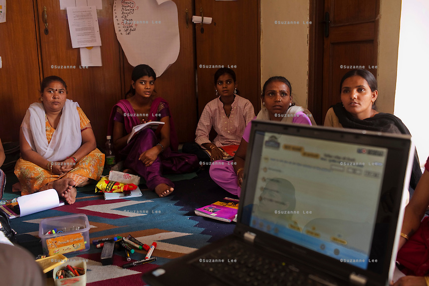 A pre-learners-licence class is held in Azad Foundation as a new batch of women prepare to take an examination for their 'L' licence.<br /> Currently training their 4th batch of students, Azad Foundation was set up by Meenu Vadera (Executive Director) in New Delhi, India, to train Indian women in driving services. Upon completion, these women work as personal drivers for a period of time before they upgrade their driving licences to commercial licences, allowing them to drive taxis. With this program, Azad aims to empower Indian women including those previously abused or trafficked, while making Delhi a safer place for women travelling in public transport. Photo by Suzanne Lee for Panos London