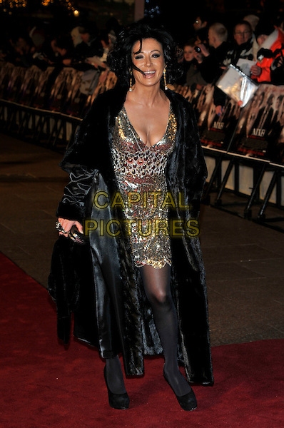 NANCY DELL'OLIO.'NINE' world film premiere.Odeon cinema Leicester Square, London, England. 3rd December 2009.full length  black coat fur gold sequined sequin cleavage low cut platform shoes tights clutch bag dress embellished .CAP/PL.©Phil Loftus/Capital Pictures.