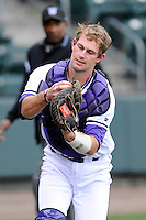 Catcher Andrew MacLatchie (19) of the Furman University Paladins catches a pop out on a game against the USC Upstate Spartans on Tuesday, March 4, 2013, at Fluor Field at the West End in Greenville, South Carolina. Furman won, 13-1. (Tom Priddy/Four Seam Images)