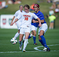 Gilda Doria (21) of Duke stays close to Emily Sonnett (16) of Virginia during the game at Klockner Stadium in Charlottesville, VA.  Virginia defeated Duke, 1-0.