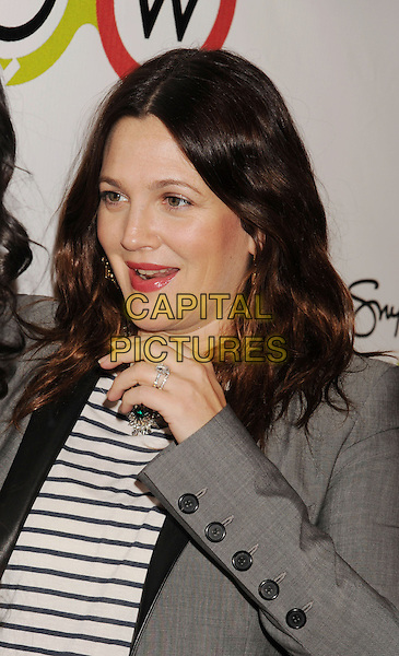 Drew Barrymore.The Opening of Kimberly Snyder's Glow Bio in West Hollywood in West Hollywood, California,.November 14th, 2012.portrait headshot lipstick pink make-up grey gray blazer jacket striped top hand arm ring mouth open half length brunette hair beauty necklace silver .CAP/ROT/TM.©Tony Michaels/Roth Stock/Capital Pictures