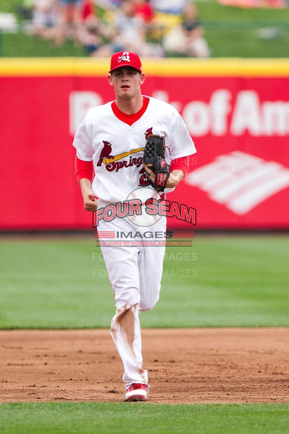 Ryan Jackson (23) of the Springfield Cardinals heads to the dugout during a game against the Arkansas Travelers on May 10, 2011 at Hammons Field in Springfield, Missouri.  Photo By David Welker/Four Seam Images.