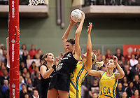 09.06.2011 Silver Ferns Anna Scarlett and Australian Diamonds Catherine Cox in action during the netball match between the Silver Ferns and Australia held at Arena Manuwau in Palmerston North. Mandatory Photo Credit ©Michael Bradley.