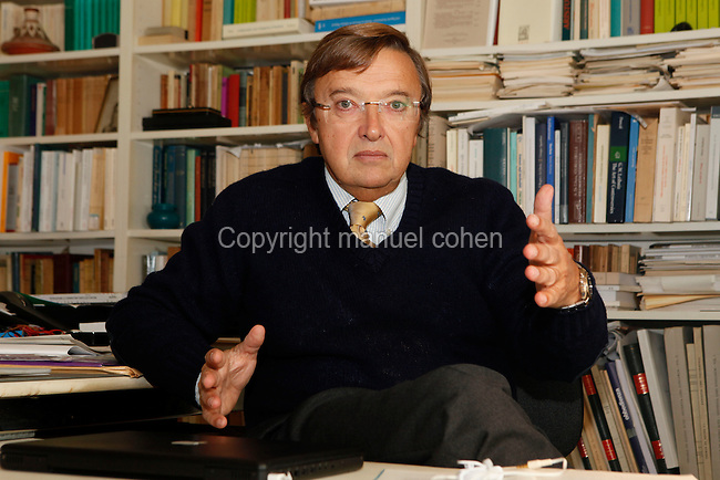 "Alain de Libera, Director of Studies at EPHE (L'Ecole Pratique des Hautes Etudes), professor at the University of Geneva, Historian of Philosophy and Medieval Theology pictured at his desk on November 04, 2009 in Paris, France. Author of ""Penser au Moyen Age"" (""Thought in the Middle Ages"", Seuil, 1991), ""Naissance du sujet"" (""The Birth of Subject"", Vrin 2007) and ""La quete de l'identite"" (""The quest for Identity"", Vrin 2008). Picture by Manuel Cohen"