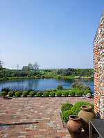 A view of the pond from the brick terrace at the rear of the house