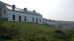Tig Peig (second house of first building on left) on the Blasket Islands, Co. Kerry. ..Picture: MacMonagle, Killarney)
