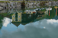Building reflections,Lake Haldensee, Nesslewangle, Reutte district. Austria.The Alps