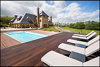 BNPS.co.uk (01202 558833)<br /> Pic:  KnightFrank/BNPS.<br /> <br /> A stunning new Arts and Crafts style country manor which comes with its own lake, swimming pool, tennis court and summer house has come on to the market for £4.95million.<br /> <br /> Recently built Thakeham Manor, which also has a helipad, is set in 16 acres of landscaped parkland near Pulborough, West Sussex.<br /> <br /> Its eye-catching design, inspired by the famous early 20th century architect Edwin Lutyens, includes a slate roof, stone quoins and brick buttresses, while inside it is full of glamorous modern touches.<br /> <br /> The luxurious property has five bedrooms, five bathrooms and six reception rooms, and its grounds contain a heated swimming pool and decking area, a circular cushioned seating area and a tennis court.