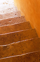 The steps of this old stone staircase have a sheen that comes from years of wear