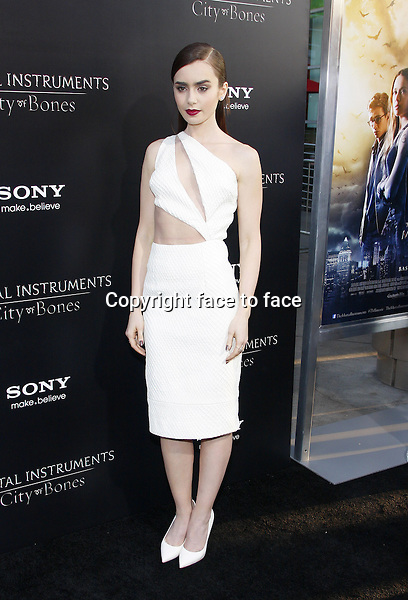 Lily Collins at the Los Angeles premiere of &quot;The Mortal Instruments: City Of Bones&quot; held at the Cinerama Dome in Hollywood in Los Angeles, California, 12.08.2013.<br />