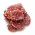 Raw seasoned pork medallions