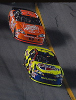 Feb 10, 2007; Daytona, FL, USA; Nascar Nextel Cup driver Kyle Busch (5) leads Tony Stewart (20) during the Budweiser Shootout at Daytona International Speedway. Mandatory Credit: Mark J. Rebilas