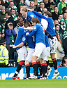 :: RANGERS' STEVEN DAVIS IS CONGRATULATED  AFTER HE SCORES RANGER'S FIRST ::