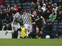 Scott Brown passes under pressure from Graham Carey in the St Mirren v Celtic Scottish Communities League Cup Semi Final match played at Hampden Park, Glasgow on 27.1.13.