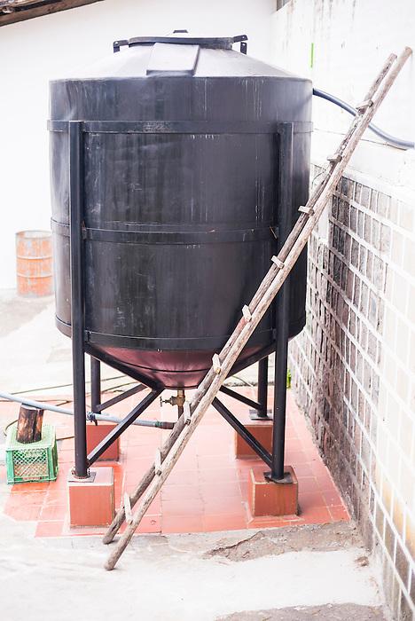 Whey container at the cheese factory at Hacienda Zuleta, Imbabura, Ecuador, South America