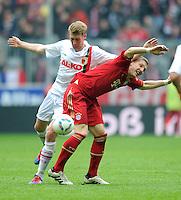 FUSSBALL   1. BUNDESLIGA  SAISON 2011/2012   29. Spieltag FC Bayern Muenchen - FC Augsburg       07.04.2012 Jan Ingwer Callsen Bracker (li, FC Augsburg) gegen Bastian Schweinsteiger (FC Bayern Muenchen)