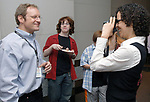 Newsday Cartoonist, Walter Handelsman is photographed by Cerene Lewis during an acknowlegement ceremony for his winning of the Pulitzer for a Portfolio of Editorial Cartoons, in the Auditorium of Newsday offices in Melville on Monday April 16, 2007. Handelsman's son James, age 15 watches in background. Photo/Jim Peppler.