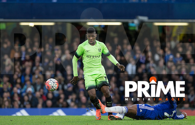 Willian of Chelsea tackles Kelechi Iheanacho of Man City during the FA Cup 5th round match between Chelsea and Manchester City at Stamford Bridge, London, England on 21 February 2016. Photo by Andy Rowland.