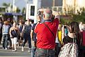 Visitor photographing the statues of the People of the food by the set designer Dante Ferretti in Expo 2015, Rho-Pero, June 2015. &copy; Carlo Cerchioli<br /> <br /> Visitatori fotografano le statue del Popolo del cibo opera dello scenografo Dante Ferretti a Expo 2015, Rho-Pero, giugno 2015.