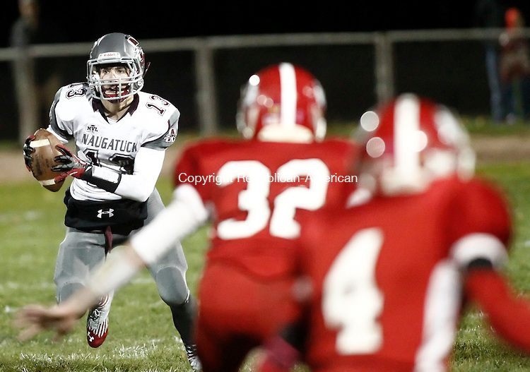 Derby, CT- 07 November 2014-110714CM06-  Naugatuck quarterback, Jason Bradley scrambles with the ball during their NVL matchup against Derby on Friday night.  Christopher Massa Republican-American