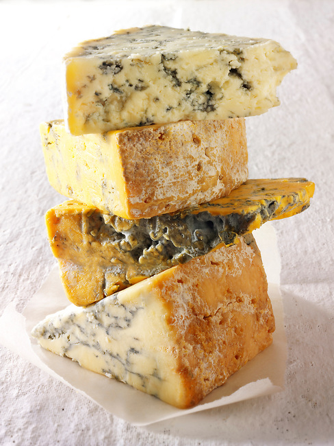 British Blue Cheese photos-From the top - Blue Vinney, Stilton, Blacksticks Blue, Creamy Stilton. Funky Stock Photos.