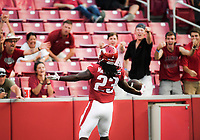 NWA Democrat-Gazette/CHARLIE KAIJO Arkansas Razorbacks running back Maleek Williams (23) reacts after running the ball for a touchdown during the fourth quarter of a football game, Saturday, September 15, 2018 at Donald W. Reynolds Razorback Stadium in Fayetteville.
