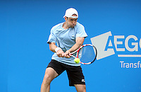 11.06.13 London, England. Benjamin Becker (GER) in action against Bernard Tomic (AUS) during the The Aegon Championships from the The Queen's Club in West Kensington.