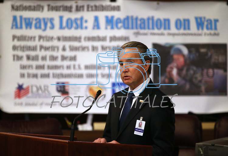 Carson City Mayor Bob Crowell speaks at the opening ceremony of the Always Lost: A Meditation on War exhibit at the Legislative Building in Carson City, Nev., on Monday, April 6, 2015. <br />