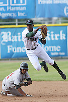 Tim Beckham of the Princeton Devil Rays turning a double playduring a game against the Greeneville Astros in an Appalachian League game at Hunnicutt Field in Princeton, WV on July 20, 2008
