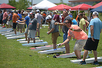 NWA Democrat-Gazette/BEN GOFF @NWABENGOFF<br /> Teams compete Friday, June 16, 2017, during the Catfish, Corndogs and Cornhole tournament at Mercy Hospital in Rogers. The event is an annual fundraiser hosted by WhyteSpyder, with proceeds from this year's tournament benefiting Mercy Health Foundation. Some 140 teams of two entered this year, according to WhyteSpyder CEO Eric Howerton.