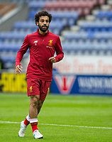 Mohamed Salah of Liverpool warm up during the pre season friendly match between Wigan Athletic and Liverpool at the DW Stadium, Wigan, England on 14 July 2017. Photo by Andy Rowland.