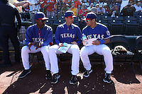 SURPRISE, AZ - MARCH 3:  Seattle Seahawks quarterback Russell Wilson talks with Texas Rangers manager Ron Washington and coach  Tim Bogar before a spring training game against the Cleveland Indians at Surprise Stadium in Surprise, Arizona on March 3, 2014. Photo by Brad Mangin