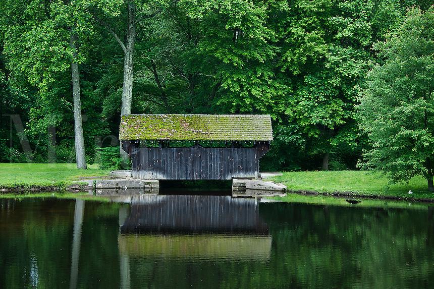 Covered bridge in a park.