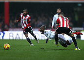 2nd December 2017, Griffen Park, Brentford, London; EFL Championship football, Brentford versus Fulham; Neeskens Kebano of Fulham goes down under the pressure from John Egan of Brentford