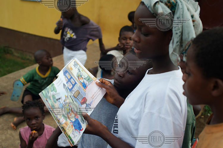 Reading from a picture book at a school in Monrovia.