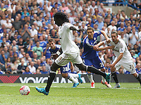 Bafetimbi Gomis of Swansea scores his sides second goal   during the Barclays Premier League match between  Chelsea and Swansea  played at Stamford Bridge, London