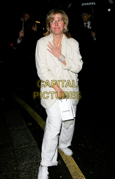 EMMA THOMPSON.The Chanel pre Autumn / Winter Collection Show at Phillips de Pury & Co, Victoria, London, England. .December 6th, 2007 .full length white trousers linen cream coat jacket scarf trainers sneakers hand funny face goody bag .CAP/AH.©Adam Houghton/Capital Pictures.